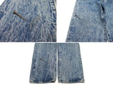 上)フロント右腿周辺の汚れ 下)フロント右裾の汚れ
